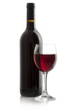 Elegant red wine glass and a wine bottle isolated on a white