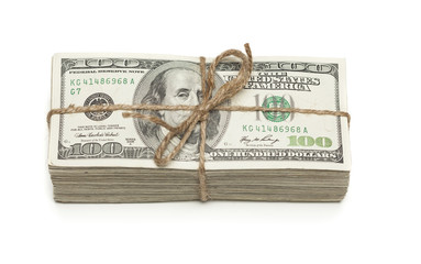 Stack of One Hundred Dollar Bills Tied in a Burlap String on Whi