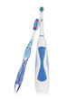 Electric and traditional toothbrushes isolated on white.