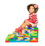 Dark skinned girl and toy blocks