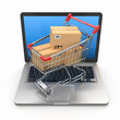 E-commerce. Shopping cart on laptop.