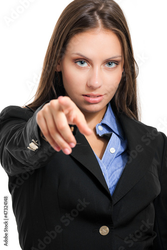 Businesswoman pointing her finger at you. Isolated on white