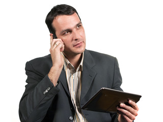 Businessman talking on the phone while holding tablet