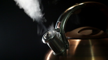 boiling kettle on a black background 4