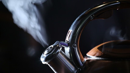 boiling kettle on a black background 1