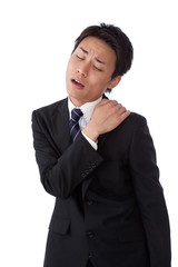 young businessman suffering from stiff neck