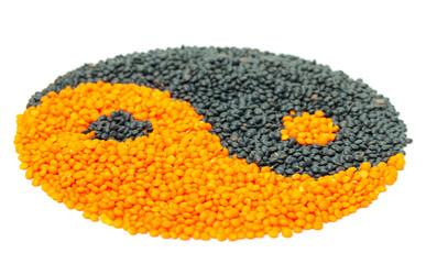 Orange and Black Lentil forming a yin yang symbol