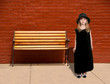 Girl Standing by Bench
