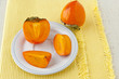 Ripe persimmon with cut