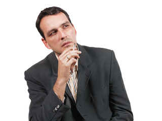 Businessman thinking and smoking cigarette
