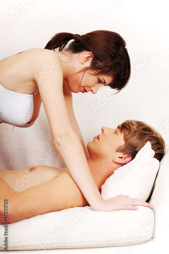 Young caucasian couple in bed