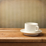 Beautiful white coffee cup over vintage background