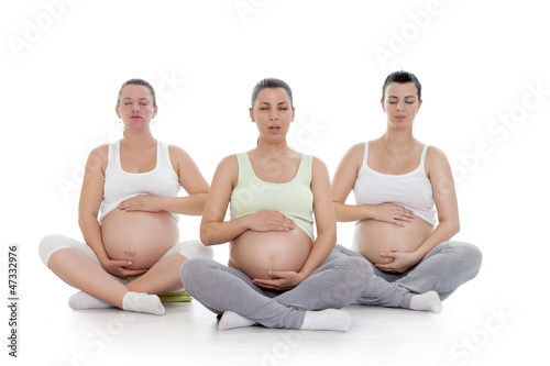 pregnant women doing breathing exercise