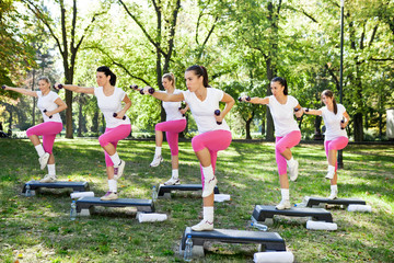 group of women doing exercises, outdoo