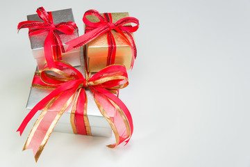 silver and gold gift box stacking