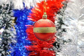 Christmas toy against the background of new year's tinsel