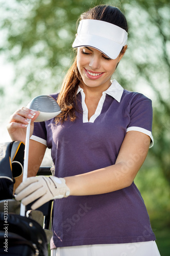 Golfer with golf equipment