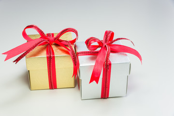 silver and gold small gift box in row