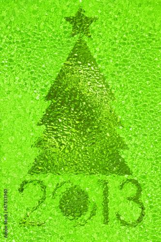 Leinwandbild Motiv Christmas tree crystal green background