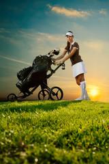 Female golfer with golf bag