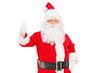A happy Santa claus standing and giving a thumb up