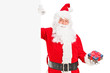 Santa claus standing next to a blank billboard and holding a gif