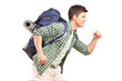 A young hiker with backpack running