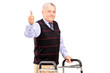 A mature gentleman using a walker and giving a thumb up
