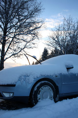Car after winter day snowfall