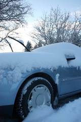 Winter car covered with fresh snow