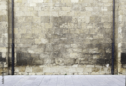 Stone wall with pipes