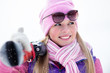 Portrait of blondy young woman with ski in winter time