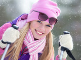 Fototapety Portrait of blondy young woman with ski in winter time