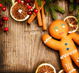 Christmas Holiday Background. Gingerbread Man over Wood