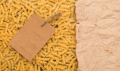 old paper on border pasta background with blank brown tag