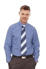 Confident businessman with hands in pockets