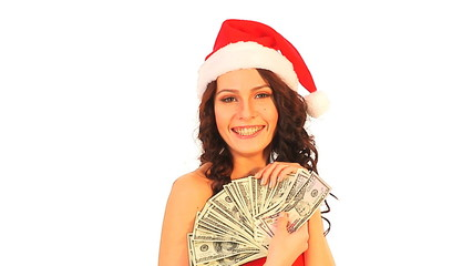 Woman in Santa hat holding money dollar.