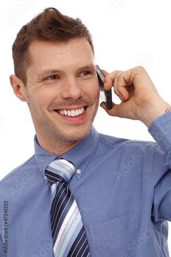 Happy businessman on phone call