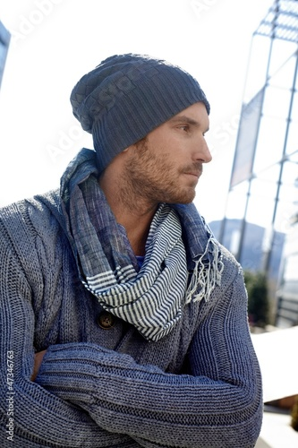 Trendy young man in hat and scarf