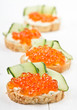 Sandwiches with red caviar and cream cheese