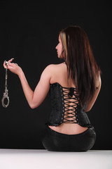 woman in latex with handcuffs