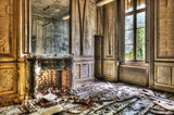 Broken fireplace in an abandoned derelict room