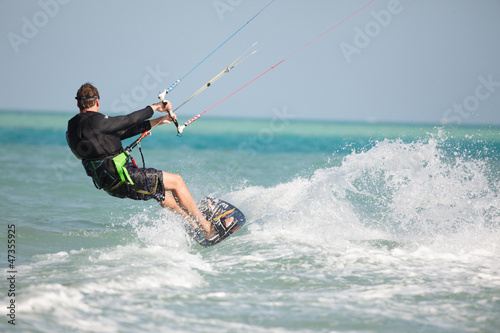 Kiteboarder enjoy surfing