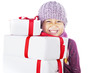 Cheerful boy giving Christmas gifts isolated in white