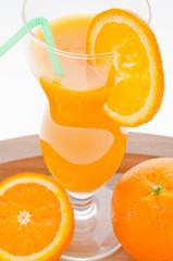 fresh orange juice with an orange