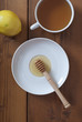Honey with tea and lemon on wooden table