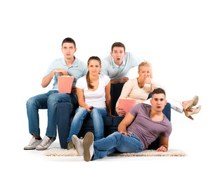 Young people sitting on a sofa on white background