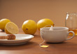 Tea with honey and lemon on wooden table