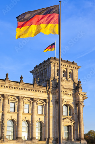 Reichstag with flags in the german capital Berlin