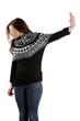 Scared woman making stop gesture sing